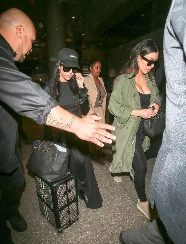 Kim and Kourtney Kardashian arriving at LAX
