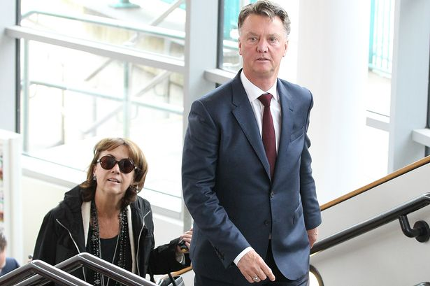 Louis van Gaal on his way out of the station with his wife Truus
