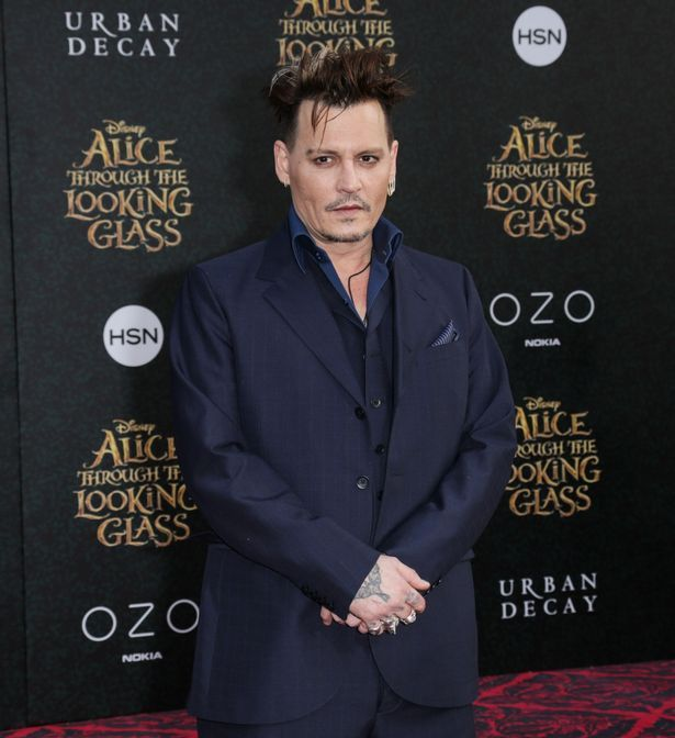 Johnny Depp arrives at Disney's 'Alice Through The Looking Glass' Los Angeles premiere