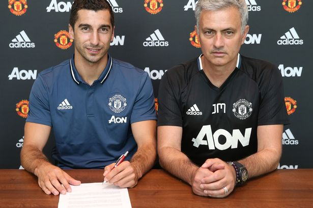 Henrikh Mkhitaryan poses with Jose Mourinho after signing for Manchester United