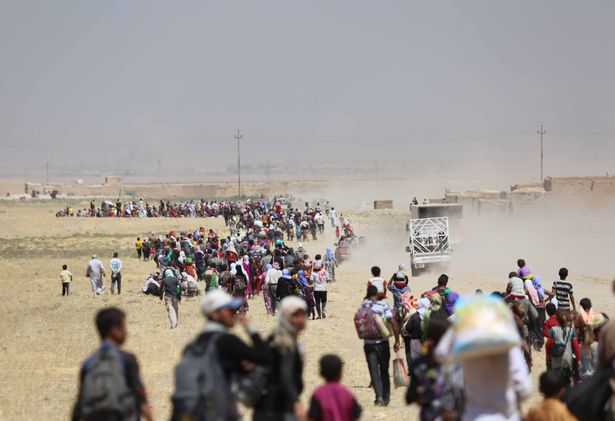 Thousands of Yezidis trapped in the Sinjar mountains as they tried to escape from Islamic State (IS) forces, are rescued by Kurdish Peshmerga forces and Peoples Protection Unit (YPG) in Mosul, Iraq