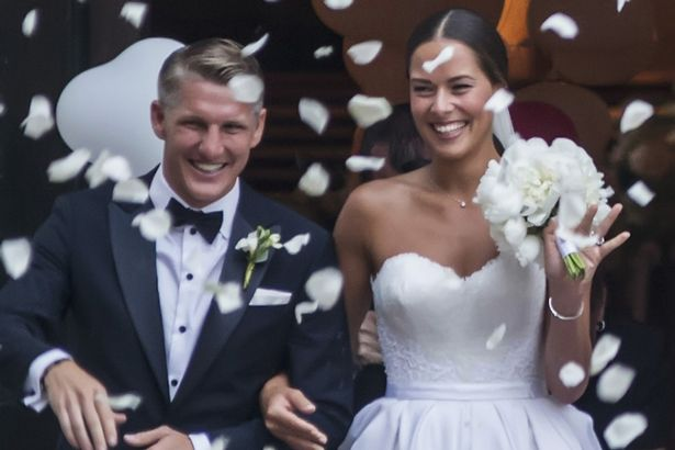 Bastian Schweinsteiger and Ana Ivanovic leave the church after their wedding