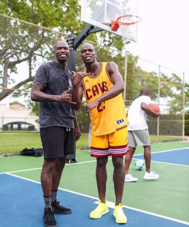 Paul Pogba with NFL player Chad Johnson on a basketball court in America