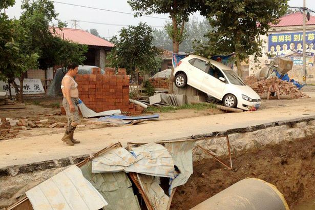 Gao Fengshou decided to save his mother instead of his wife during flooding in Daxian, China. Pictured - flood damage in Daxian