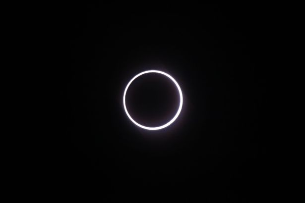 Photo taken on September 1, 2016, in Saint-Louis, on the Indian Ocean island of La Reunion, shows the moon covering the sun, leaving a ring of fire effect around the moon, during an annular solar eclipse