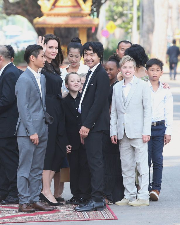 A radiant Angelina Jolie and her six children