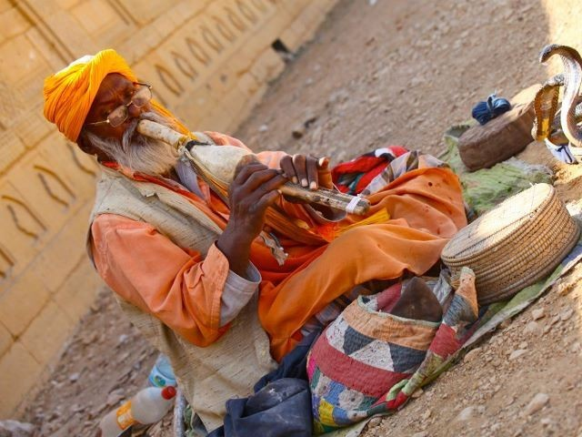 Traditional snake charmers are often seen at shrines and mausoleums. PHOTO: FARAH KAMAL