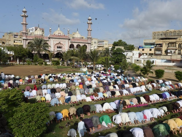 Devotees offer Eidul Azha prayers outside a mosque in Karachi on September 25, 2015. PHOTO: AFP