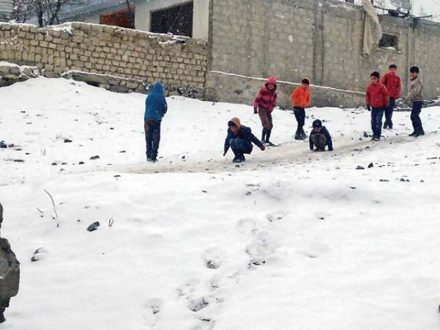 Children play in snow in Skardu. PHOTO COURTESY: RAZA QASIR