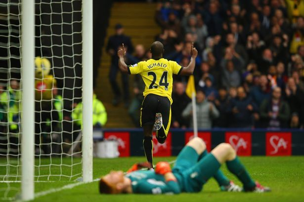 Adam Bogdan of Liverpool (front) looks dejected as Odion Ighalo of Watford celebrates as he scores their third goal during the Barclays Premier League match between Watford and Liverpool