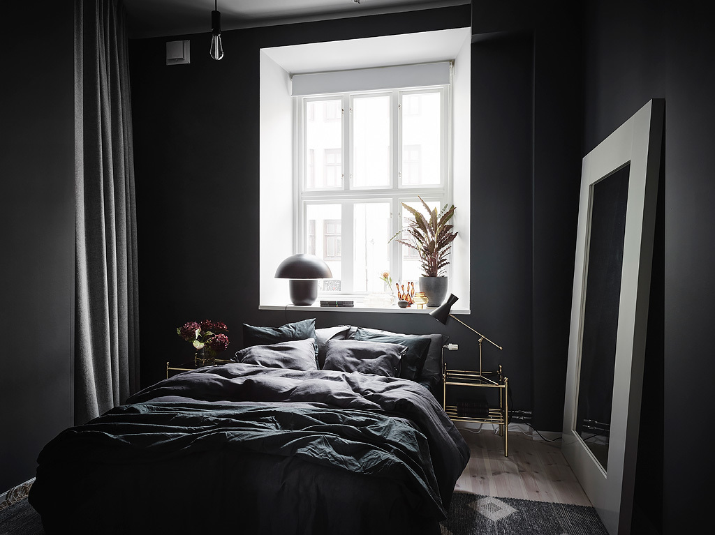 Exposed brick and black bedroom walls  COCO LAPINE