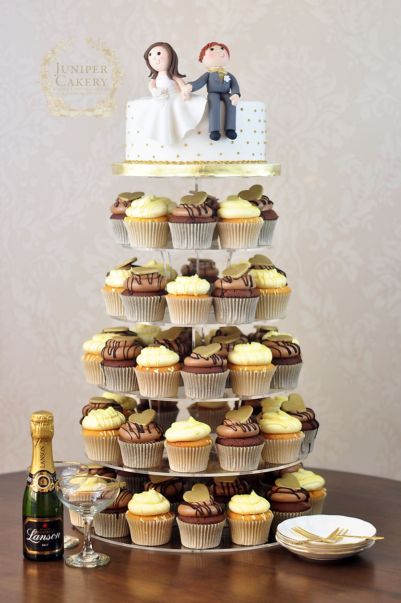 Fun Wedding Cupcake Tower with Bride and Groom