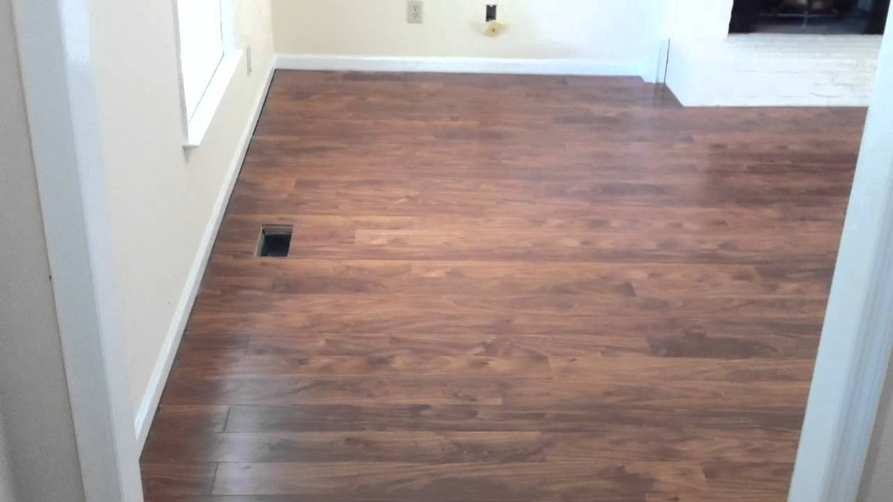 Laminate flooring flowing between rooms without a T