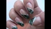 teal & black crackle nail design