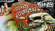 painting surfboard with tattoo-style