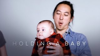 Holding a Baby for the First Time in Slow Motion | First Takes | Cut