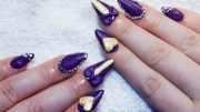 sculpted purple & gold almond nails