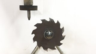 Saw Blade Fidget Spinner Powered By 60,000 PSI Waterjet - water cutting metal