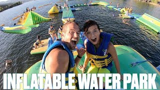 WORLDS BIGGEST INFLATABLE WATER PARK | FLOATING WATER SLIDE OBSTACLE COURSE