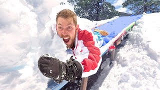 Water Slide Into A Wall Of SNOW!
