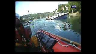 Sinking motorboat saved by Dart lifeboat and local boatmen