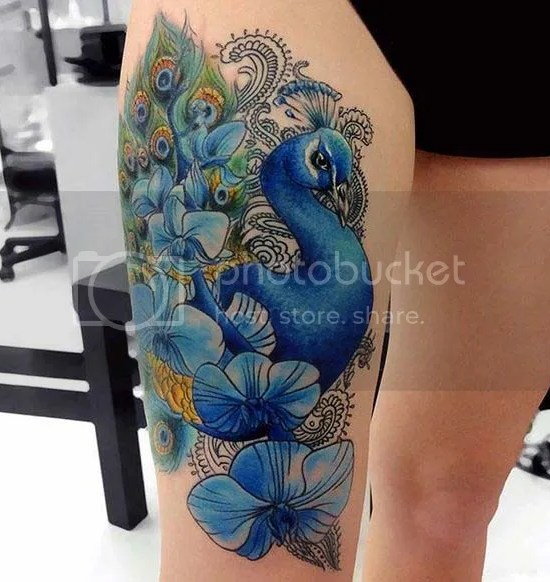 Beautiful peacock tattoo design on thigh