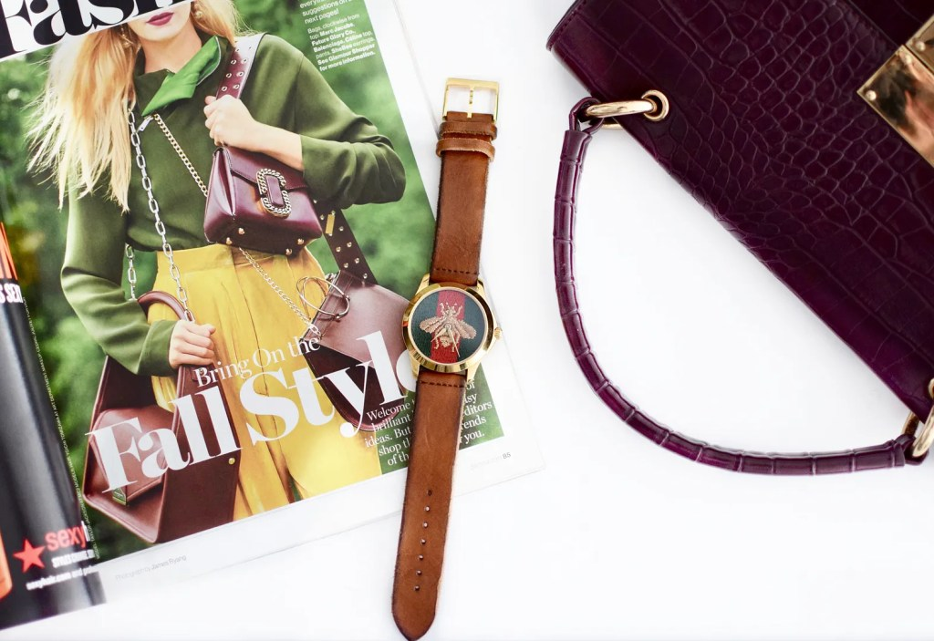Gucci timeless watch with gold bee and red and green stripes leather strap