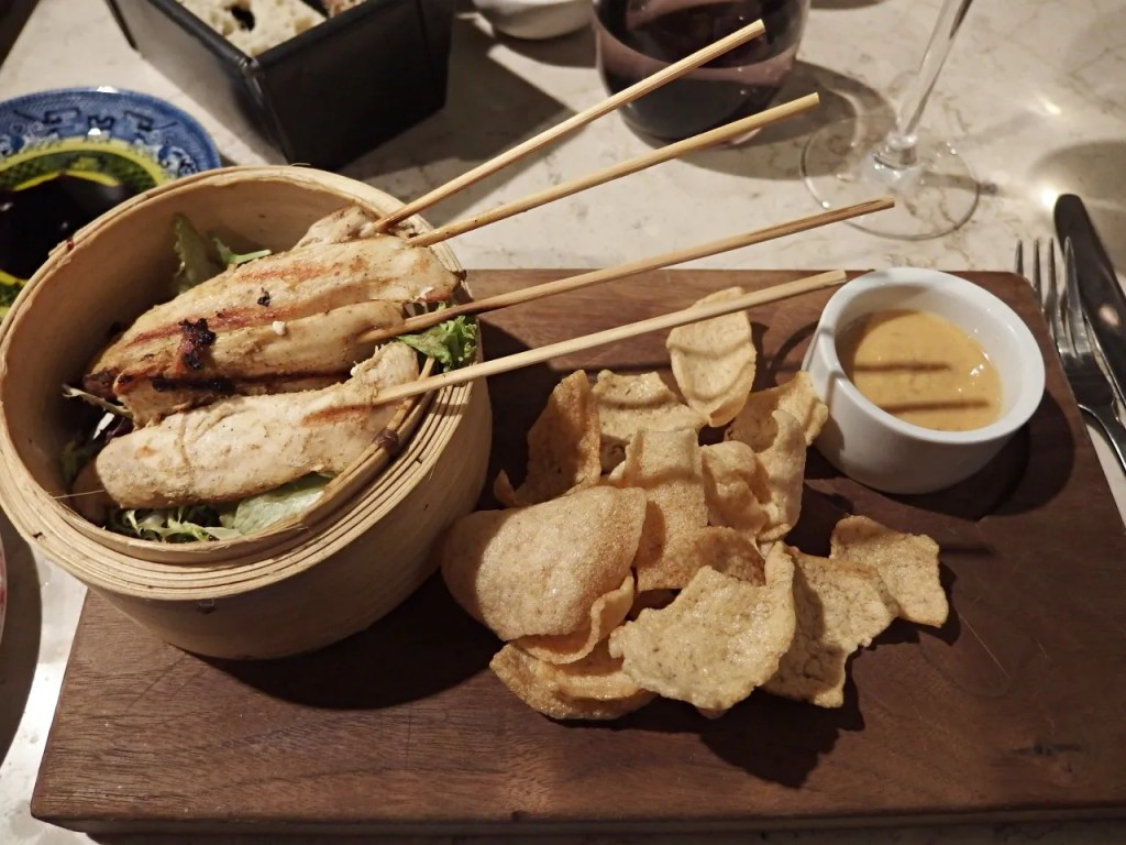 chicken satay and prawn crackers and peanut sauce