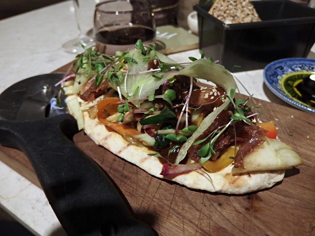 duck flatbread at the fable london