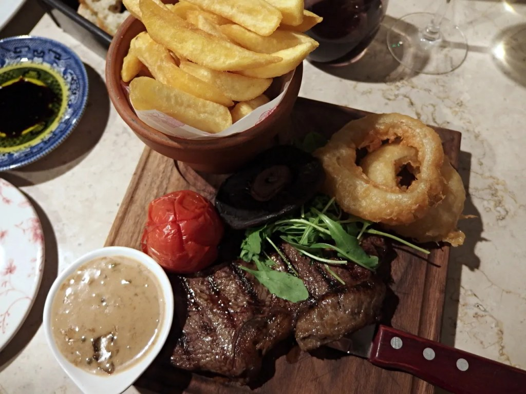 Sirloin steak and fries and onion rings