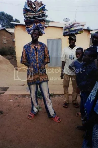 Vendor in Natitangou, Benin, trying the diabalo