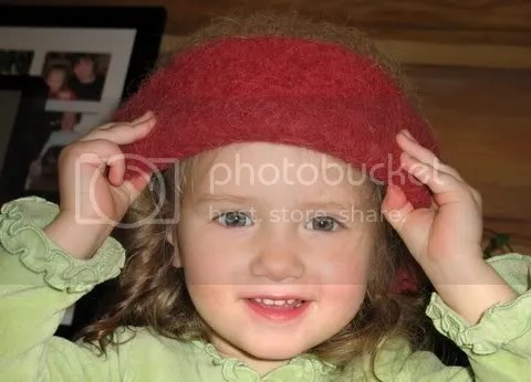 Carrie Cahill Mulligan's youngest Felt Hat Fan Club member, Riley T. tries on her mother's hat