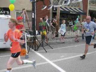Crossing the finish line in the first race of the Frankfort Trifecta, the Run for the Gold 3K - Frankfort, Kentucky