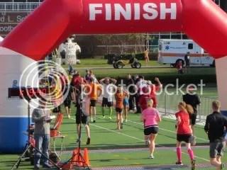 Me crossing the finish line of the Papa John's 10 Miler - Cardinal Stadium, Louisville, Kentucky