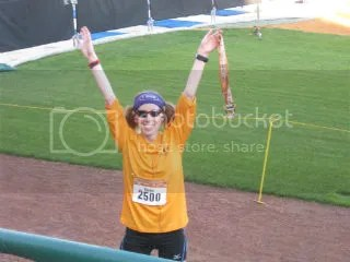 Me celebrating  at the finish line of the Republic Bank Big Hit 1/4 Marathon with finisher's medal in hand