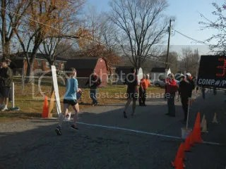 Me crossing the finish line of the Fast Freddie Five Mile Foot Feast - New Albany, Indiana