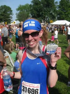 Me with my finisher's medal at the OneAmerica 500 Festival Mini Marathon - Indianapolis, Indiana