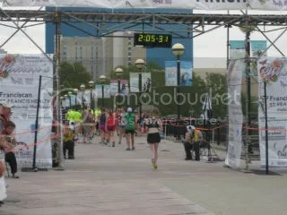 Me crossing the finish line of the Indianapolis Women's Half Marathon – Indianapolis, Indiana
