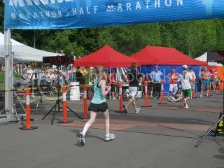 Me crossing the finish line of the Minneapolis Half Marathon – Minneapolis, Minnesota
