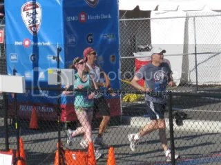 Me crossing the finish line of the Rock 'N Sole Quarter Marathon - Milwaukee, Wisconsin