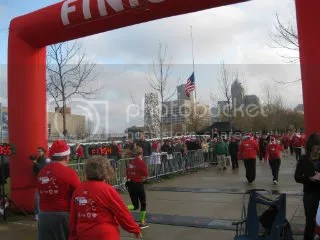 Me crossing the finish line of the Santa Hustle Half Marathon - Indianapolis, Indiana