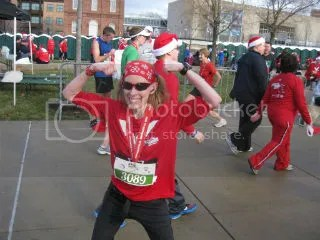 Me celebrating my new PR at the Santa Hustle Half Marathon - Indianapolis, Indiana