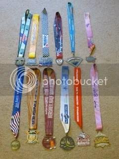 10K - Half Marathon Medals - Top Row: Chicago Half Marathon (2011), Big Hit Quarter Marathon (2011), OneAmerica 500 Festival Mini Marathon (2012), Rock 'N Sole Quarter Marathon (2012), Minneapolis Half Marathon (2012), Indianapolis Women's Half Marathon (2012); Bottom Row: Air Force Marathon 10K (2012), Big Hit Quarter Marathon (2012), Hershey Half Marathon (2012), Louisville Sports Commission Half Marathon (2012), Santa Hustle Half Marathon (2012), Disney Princess Half Marathon