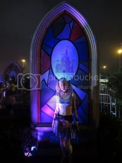 Me in front of the Cinderella's Castle stained glass backdrop before the race.