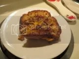 A grilled cheese sandwich made with Udi's Gluten-Free Omega Flax and Fiber Bread and vegan cheese slices