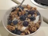 Kind Healthy Grains Vanilla Blueberry Clusters with Flax Seeds over fresh blueberries and Chobani Vanilla Greek Yogurt