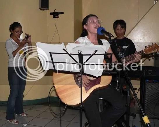 Dinda enjoying her twin sisters band