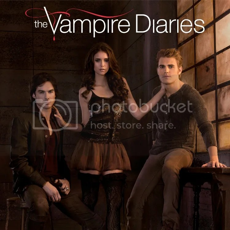 The Vampire Diaries's Elena Gilbert posing with brothers Stephen and Damon Salvatore.