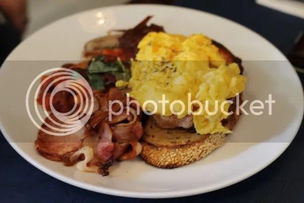 Deli Breakfast – free range eggs on toast, bacon, Italian pork sausages & baked beans
