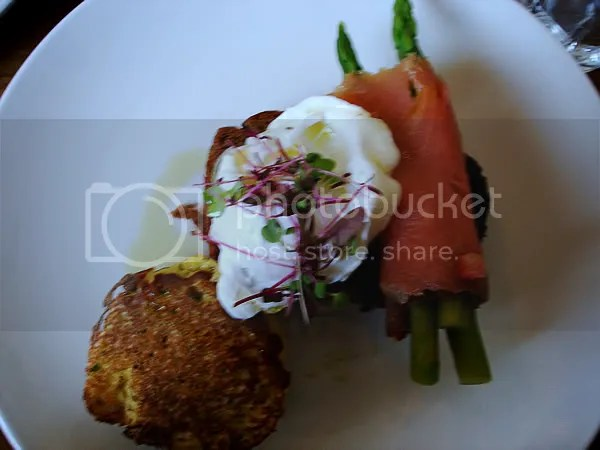 Potato and chive pancakes, poached egg, salmon & asparagus on pumpernickel brioche